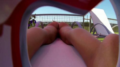 Blonde_sunbathing_near_the_pool